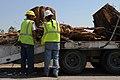 Clearing tree stumps after Joplin tornado (5893461941).jpg