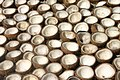 Coconuts drying before being processed into copra, Polomuhu village, Central Province, Solomon Islands 2004. Photo- Peter Davis - AusAID (10687170956).jpg