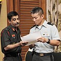 Col. P.K. Singh and Col. David Shin work together during the Indian Executive Steering Group.jpg