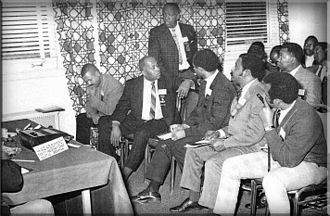 International Association of Black Professional Firefighters - Lieutenant Nelson, standing rear, of the Oklahoma City, OKFD speaks on the subject of harassment at the 1st conference of the IABPFF, Oct 31-Nov 01, 1969