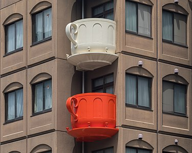 Cream and red coffee cup-shaped balconies in Tokyo