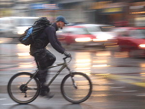 Cyclist in Edinburgh against blurry motor traffic