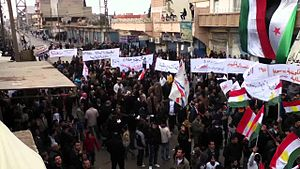 Rojava conflict - Kurds, Assyrians, and Arabs demonstrate against the Syrian government in Qamishli, 6 January 2012