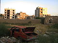 Destroyed red car in a abandoned zone nearnear amin eslami garden- Nishapur 2.JPG