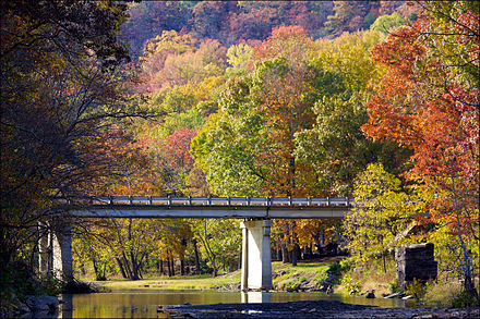 Devil's Den State Park, a state park in Washington County, in the fall. Devil's Den bridge.jpg