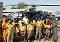 Differently abled and special children get close to an Indian Navy helicopter at INS Shikra.jpg