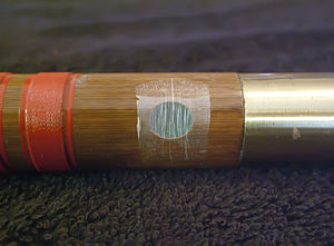 Dizi (instrument) - Close-up of the di mo on a dizi, as well as the metal joint of a dizi.