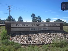 A sign displaying the name and address of the Douglas County High School