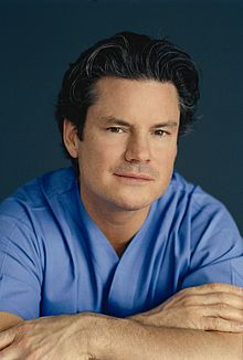 Dr Mulholland Arms Crossed In Scrubs.jpg