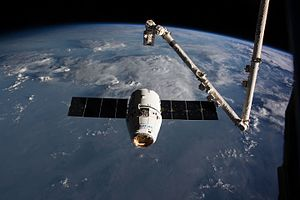 Dragon approaches the ISS (32269420513).jpg