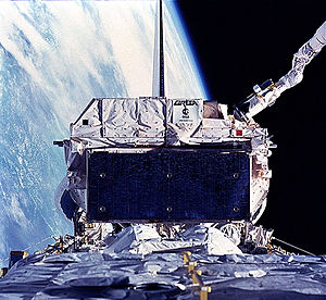 STS-57 - EURECA is stowed by Endeavour's remote manipulator system (RMS)