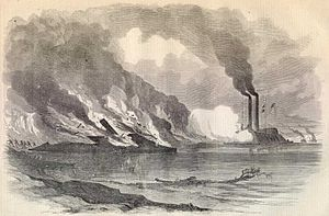Battle of Baton Rouge (1862) - The Essex fires on the burning Arkansas