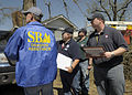 FEMA - 40807 - Officials performing Preliminary Damage Assessment in Arkansas.jpg