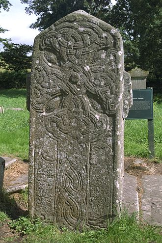 Áed Uaridnach - West face of the Fahan cross-slab, the figures at the bottom perhaps representing Áed Uaridnach and Saint Mura, founders of the church at Fahan