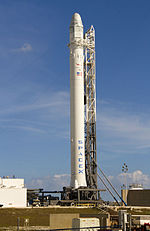 Falcon 9 with Dragon capsule for tests on pad.jpg