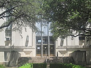 Marlin, Texas - Glimpse of Falls County Courthouse, shaded by large trees