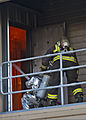 Federal Fire Department Firefighting Recruit Training Academy Recruits enter a building during training at the Mamala Bay training area on Joint Base Pearl Harbor-Hickam in Pearl Harbor, Hawaii March 20, 2013 130320-N-WF272-026.jpg