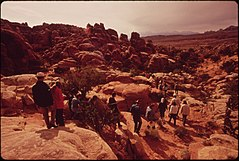 Fiery Furnace Is an Intricate Maze of Narrow Canyons. A Ranger Naturalist Guides Tourists through It, Explaining Its Plant and Animal Life and Geology, 05-1972 (3857070596).jpg
