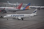 Finnair Embraer 190LR (OH-LKR) taxiing at Manchester Airport (1).jpg