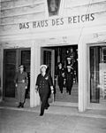 Fleet Admiral Ernest J. King leaves the headquarters of US Ports and Bases in Bremen, Germany, 23 July 1945.jpg