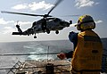 Flickr - Official U.S. Navy Imagery - A Sailor assigned to the guided-missile destroyer USS Halsey directs an SH-60 Sea Hawk helicopter..jpg