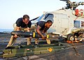 Flickr - Official U.S. Navy Imagery - Sailors load a Hellfire missile..jpg