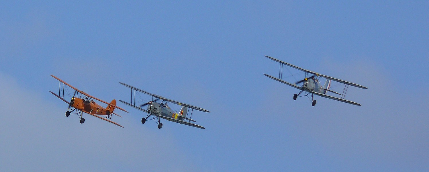 Flight of three Stampe en Vertongen SV.4 at the festivities commemorating 100 years of Aviation Week at Temse. From left to right V4, V29 and OO-GWC.  SV.4B V4 (OO-EIR) was built in 1948, this is the first of 65 SV.4B's delivered to the Belgian Air Force.  SV-4B V29 (OO-GWB; C/N: 1171) was built in 1951 and delivered to the Belgian Air Force as V29. It is painted in the colours it had in the 1950s.  SV-4A OO-GWC (c/n 1 (French)) is the first French built SV.4.