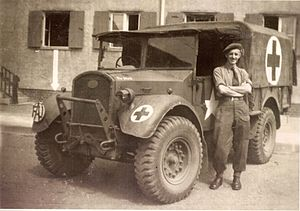 Friends' Ambulance Unit - Frank J. Stevens, a Friends Ambulance Unit ambulance driver, with his vehicle in Wolfsburg, Germany, possibly 1945