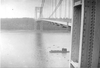 USS Nautilus (SSN-571) - Nautilus passes under the George Washington Bridge during a visit to New York Harbor in 1956