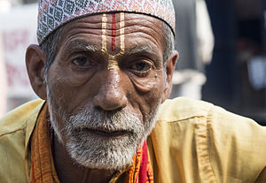 Hinduism in Nepal - Nepali Brahmin (Bahun) wearing Dhaka topi; Bahun priests are associated with priestly works