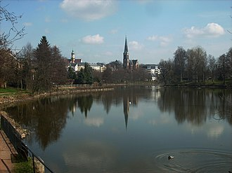 Geringswalde - View across pond towards Martin Luther church and town hall
