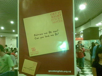 Speak Good English Movement - A Get It Right Poster at a food-court displaying a correction of ungrammatical English.