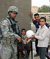 Gimlets hand out soccer balls DVIDS82519.jpg
