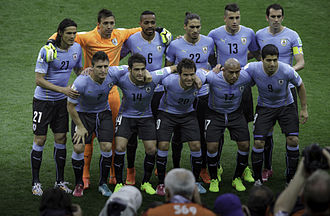 Egidio Arévalo Ríos - Arévalo (wearing number 17) lining up for a team photo with his compatriots during the group stage of the 2014 FIFA World Cup.