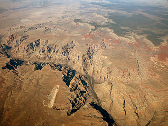 Grand Canyon Skywalk - Aerial view: Grand Canyon West  Airport at left center. Grand Canyon National Park lands (top), north of the Colorado River.