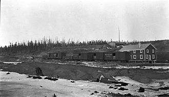 Grand Trunk Pacific Railway - Grand Trunk Pacific boxcars and gondola in Lovett, Alberta. About 1915.