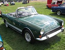 Dark-green open-top sports car