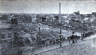 Grover Shoe Factory disaster - View of disaster, March 1905. The curved white line shows path of boiler.