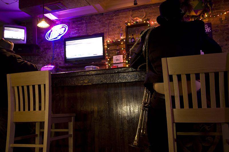 File:Guy at Royal St bar.jpg