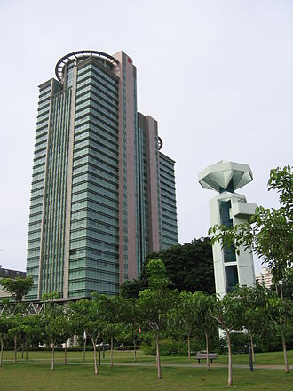 Toa Payoh - The distinctive viewing tower at Toa Payoh Town Park to the right, with the tower block of HDB Hub in the background.