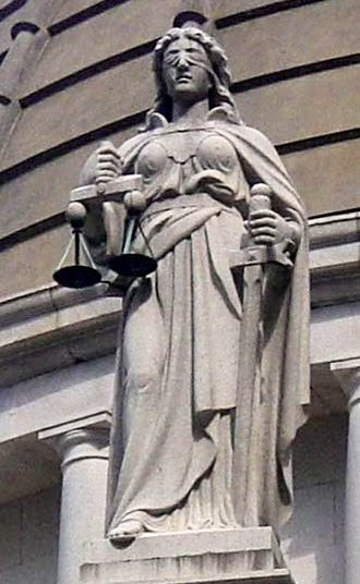 Lady Justice - Justitia blindfolded and holding balance scales and a sword. Court of Final Appeal, Hong Kong