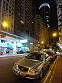 HK Wan Chai night Johnston Road sidewalk carpark Benz HKJC.JPG