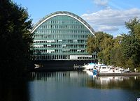 A waterbody with a multi-storey office building, built as an arch in whole.