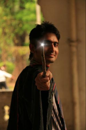Harry Potter fandom - A fan imitates Harry casting the Lumos spell