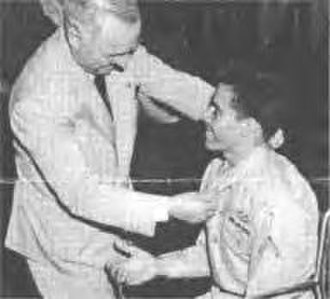 Silvestre S. Herrera - President Truman decorates Silvestre S. Herrera at the White House, August 23, 1945