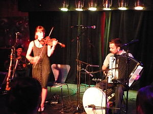 Jeremy Barnes - Three members of  A Hawk and a Hacksaw performing at the Dionysus Club. From left to right: Mark Weaver, tuba; Heather Trost, violin; Jeremy Barnes, accordion and percussion