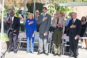 Marsy's Law - Henry T. Nicholas and his mother, Marcella Leach, join John Gillis, former National Director, U.S. Department of Justice Office for Victims of Crime, Los Angeles County Sheriff Lee Baca and then-California Attorney General Jerry Brown at the annual National Day of Remembrance event in downtown Los Angeles.