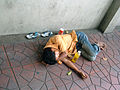 Homeless man sleeping in Bangkok.JPG
