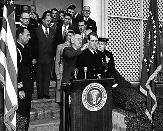 Thomas J. Hudner Jr. - Hudner receives the Medal of Honor from President Harry S. Truman on 13 April 1951.