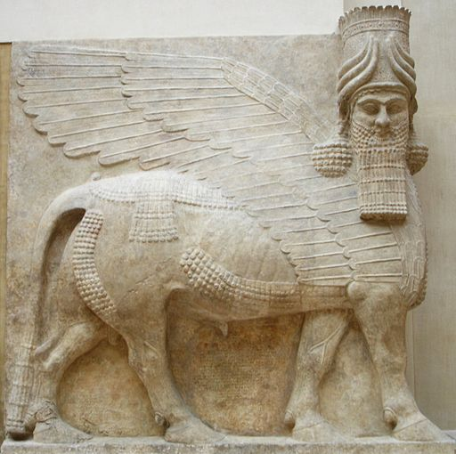 Human headed winged bull facing